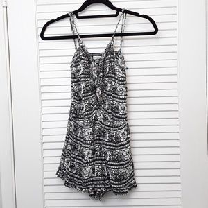 American Eagle Outfitters Romper Ruffle Hem Floral